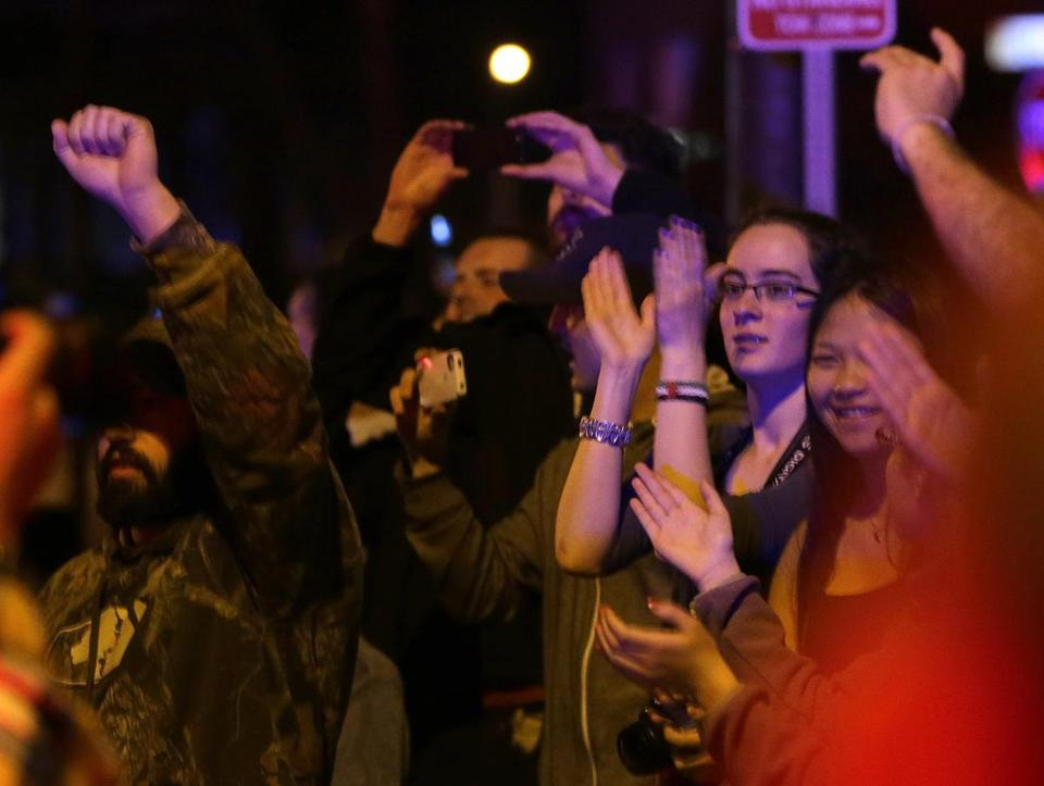 Bystanders cheered at the scene after it was announced the suspect had been captured.
