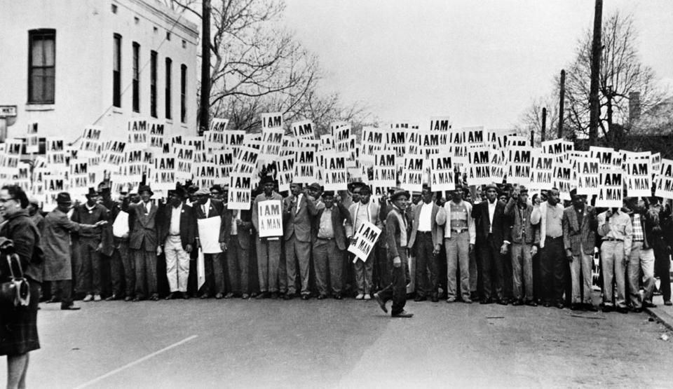 "Ernest C. Withers's photograph of striking Memphis sanitation workers is displayed in large and small form in ""For All the World to See."""