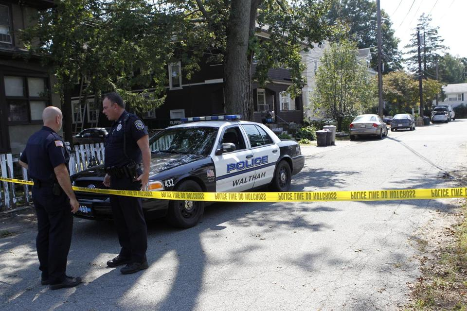 Waltham police closed off Harding Avenue on Sept. 13, 2011, the day after three men were found dead in an apartment.