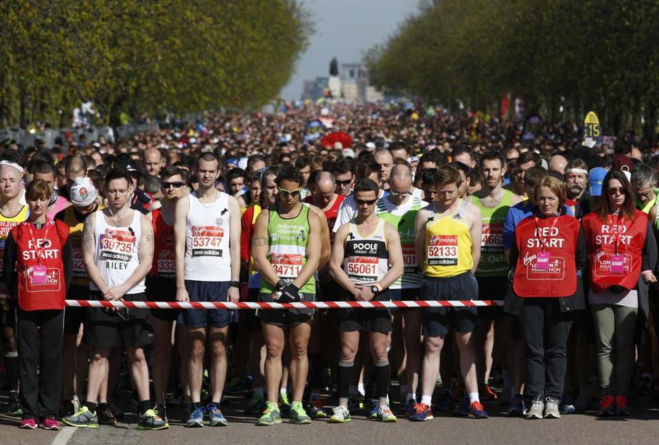 Runners held Boston's victims in their hearts as they observed a moment of silence before the London Marathon's start.