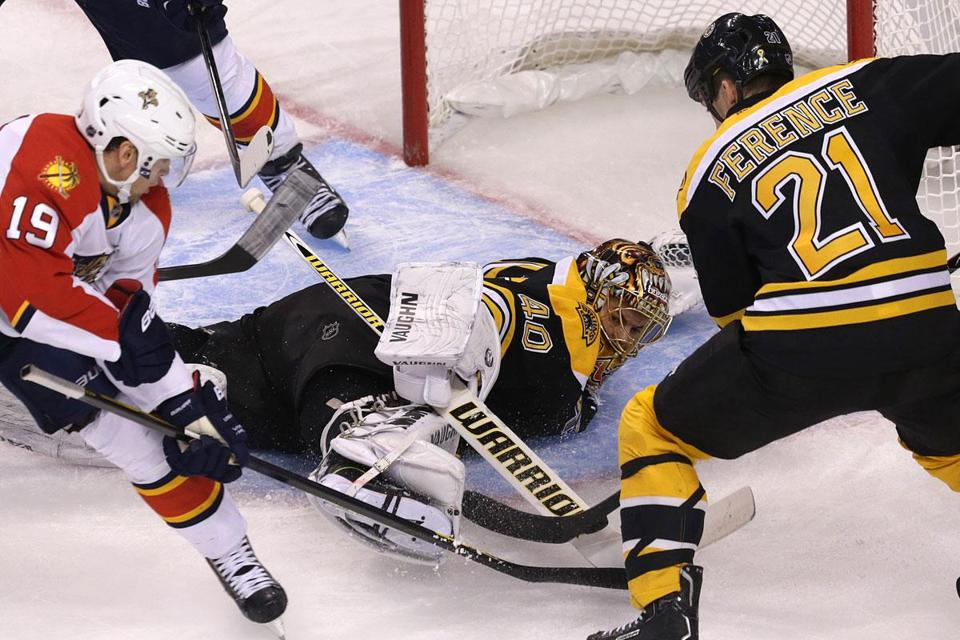 With Florida's Scottie Upshall sniffing around, Bruins goalie Tuukka Rask makes a save during the second period.