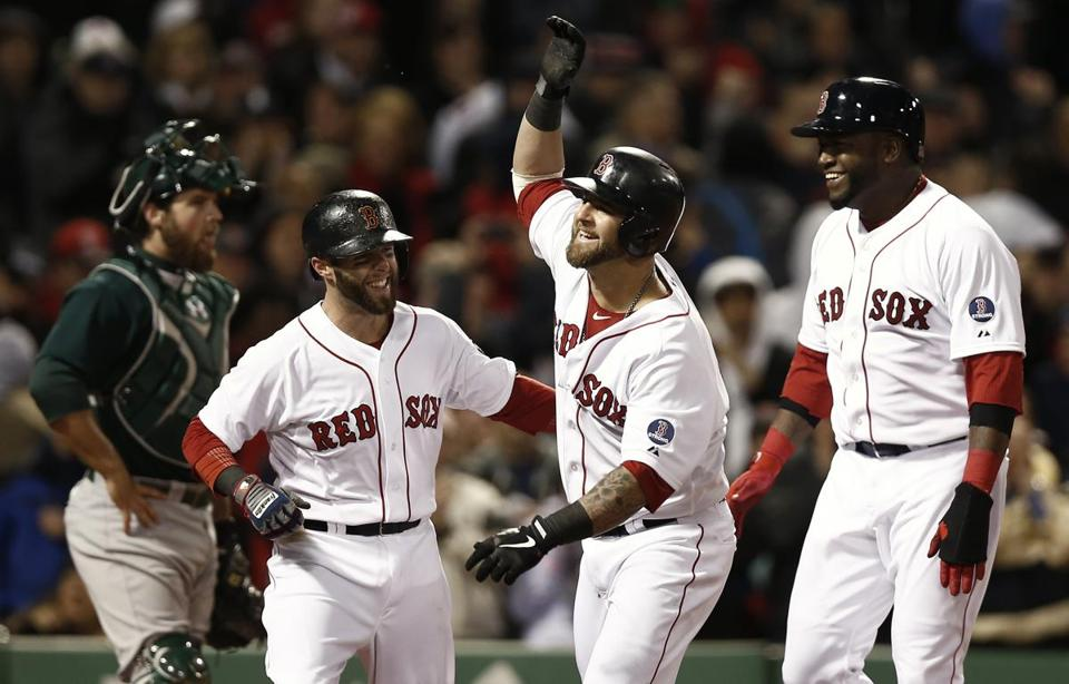 Mike Napoli celebrated his grand slam with teammates David Ortiz, right, and Dustin Pedroia.