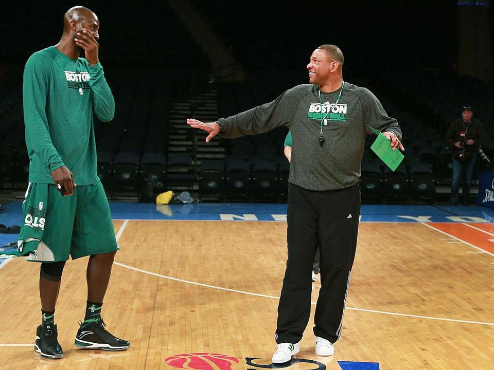 Kevin Garnett and coach Doc Rivers laugh before practice, in which serious work was done.