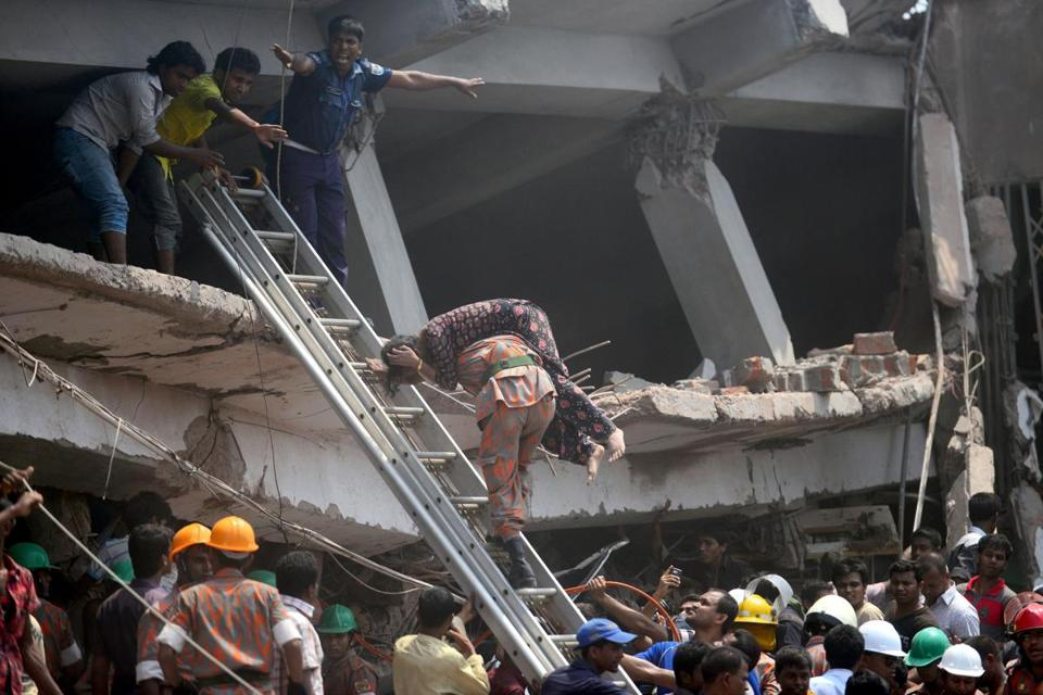 A Bangladeshi firefighter rescued an injured garment worker Wednesday after a building collapsed in Savar.