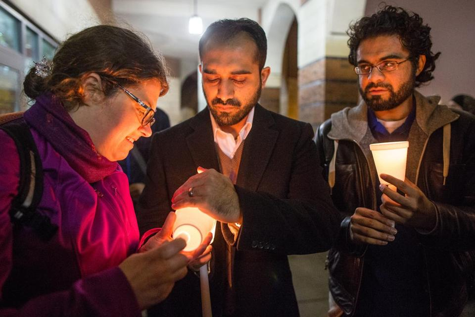 From left, Alliea Groupp and brothers Awais Kazi and Abdullah Kazi participated in a vigil for bombing victims Tuesday at the Islamic Society of Boston Cultural Center in Boston.