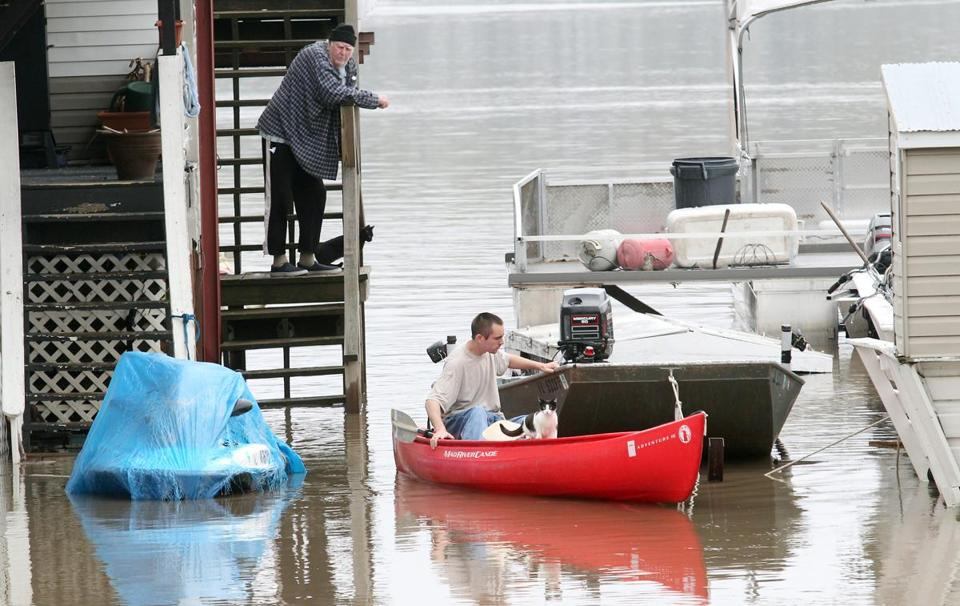 Residents dealt with high water in Grafton, Ill. The biggest problem areas were in Illinois. In Peoria Heights, roads and buildings were flooded and riverfront structures inundated.