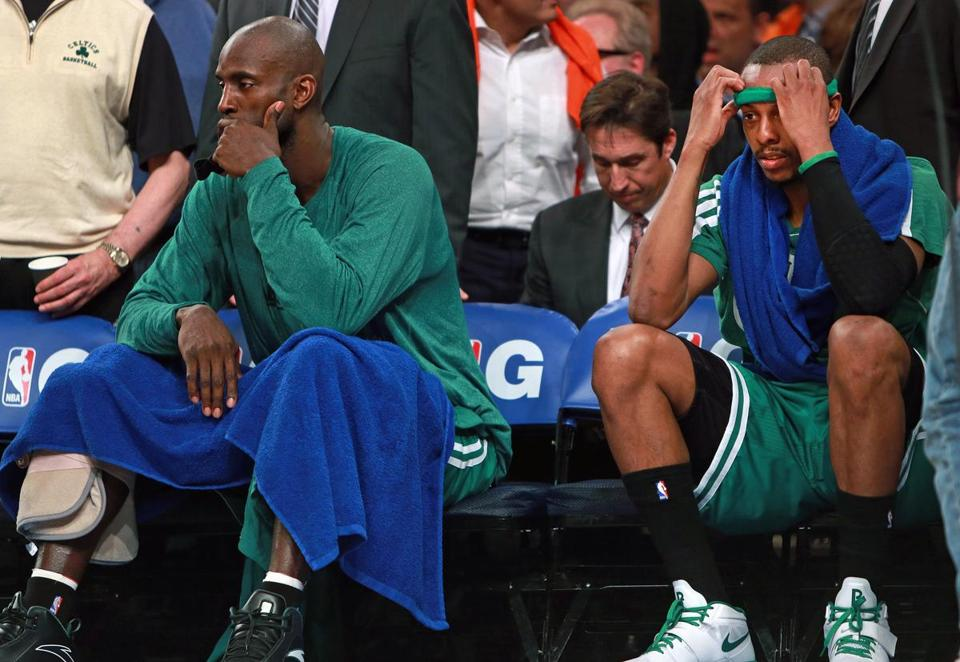 Kevin Garnett, left, and Paul Pierce were left dejected on the Celtics bench late in the game.