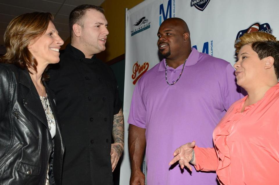 From left: Carla Gomes, mother of a Joslin patient, Cobblestone chef Josh Breen, Vince and Bianca Wilfork.
