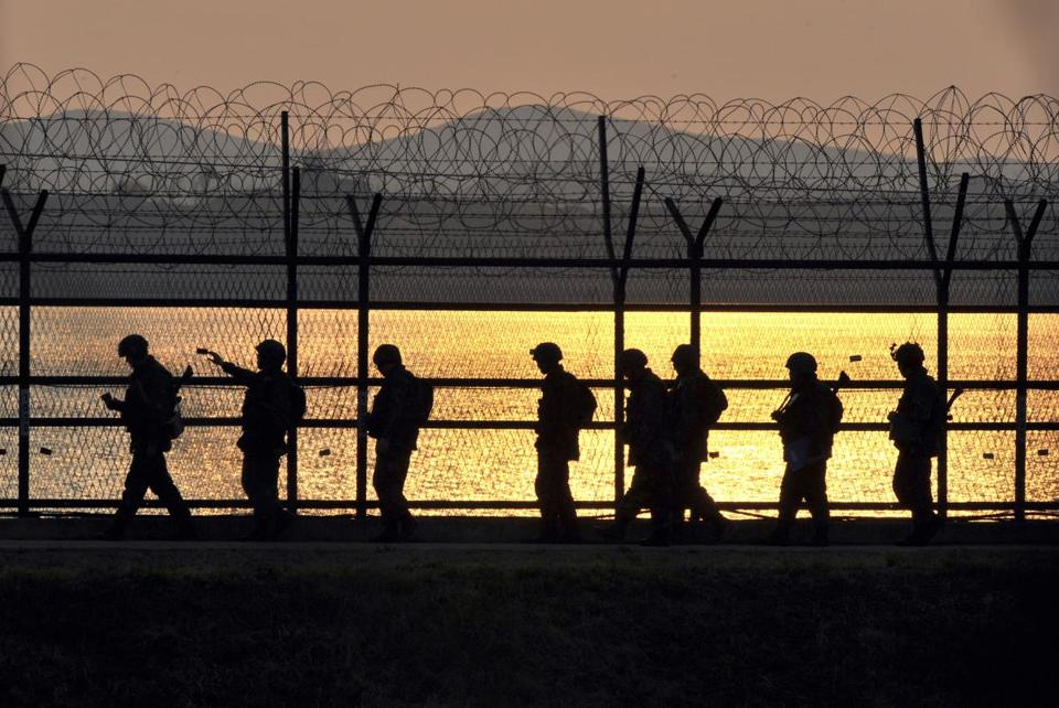 South Korean soldiers patrolled along the military fence near the Demilitarized Zone that divides the two Koreas.