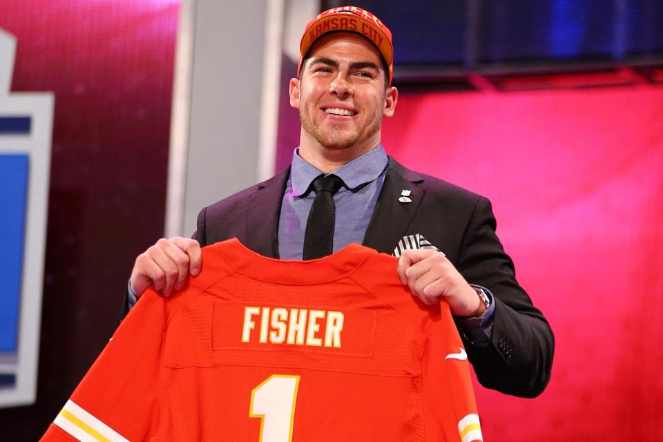 Eric Fisher of Central Michigan held up a jersey on stage after he was picked No. 1 overall by the Kansas City Chiefs.