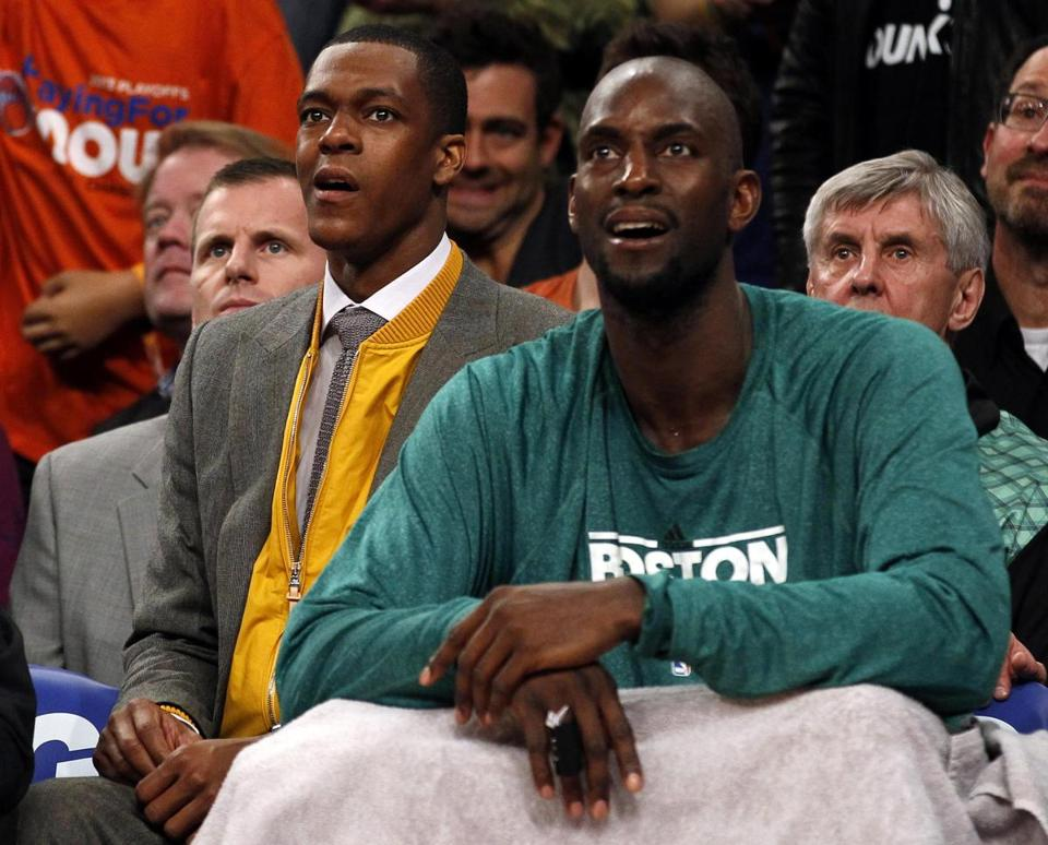 Rajon Rondo, left, has been a spectator watching Kevin Garnett and the Celtics in the playoffs.