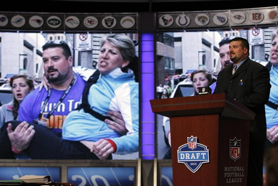 The NFL honored former Patriots lineman Joe Andruzzi for his efforts helping victims at the Boston Marathon attack during the draft. He was supposed to announce the Patriots' pick, but instead announced the team had traded its selection to Minnesota.