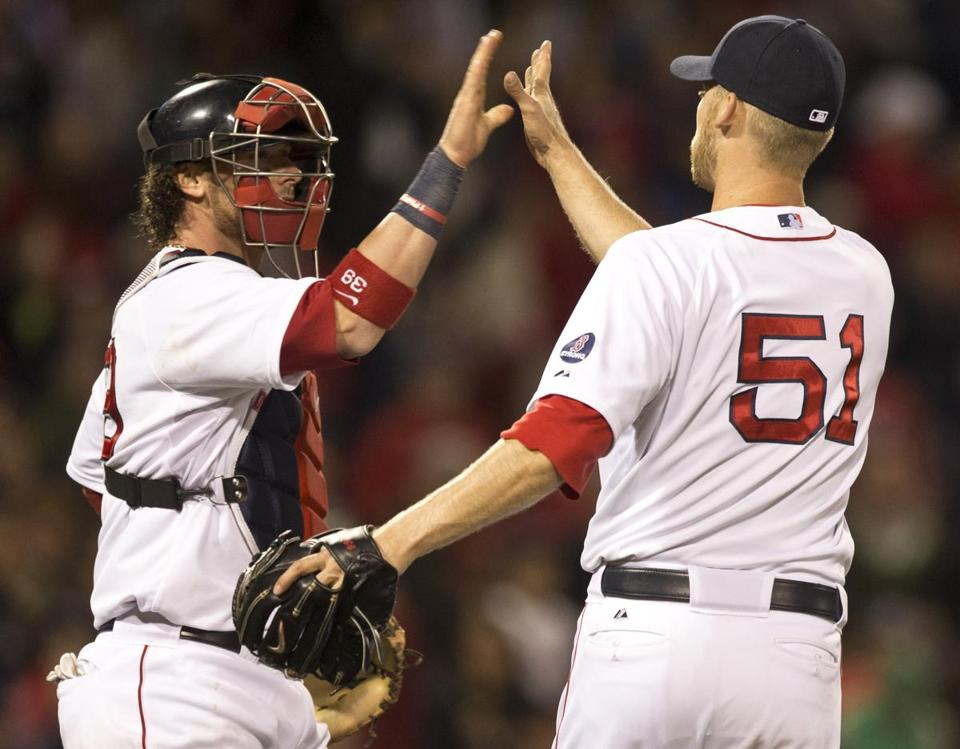 Jarrod Saltalmacchia (left) high-fived teammate Daniel Bard after they defeated the Houston Astros 7-2.