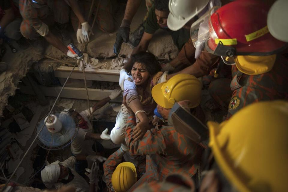 Rescue workers pulled a garment worker from a collapsed building in Savar, Bangladesh.