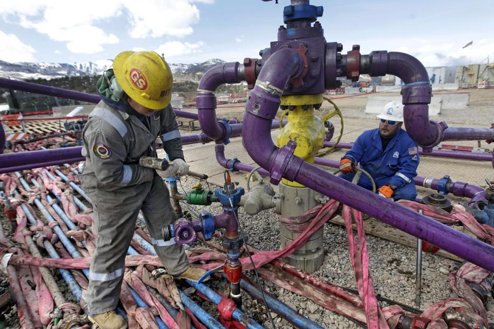 Workers from Encana Oil & Gas (USA) Inc. tended to a wellhead during a hydraulic fracturing operation in March at a well outside Rifle, Colo.