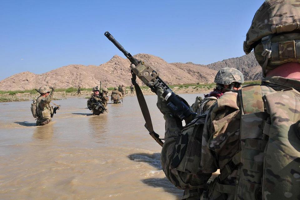 US soldiers crossed the Tarnak River in Kandahar Province on a mission to clear the area of explosives caches.