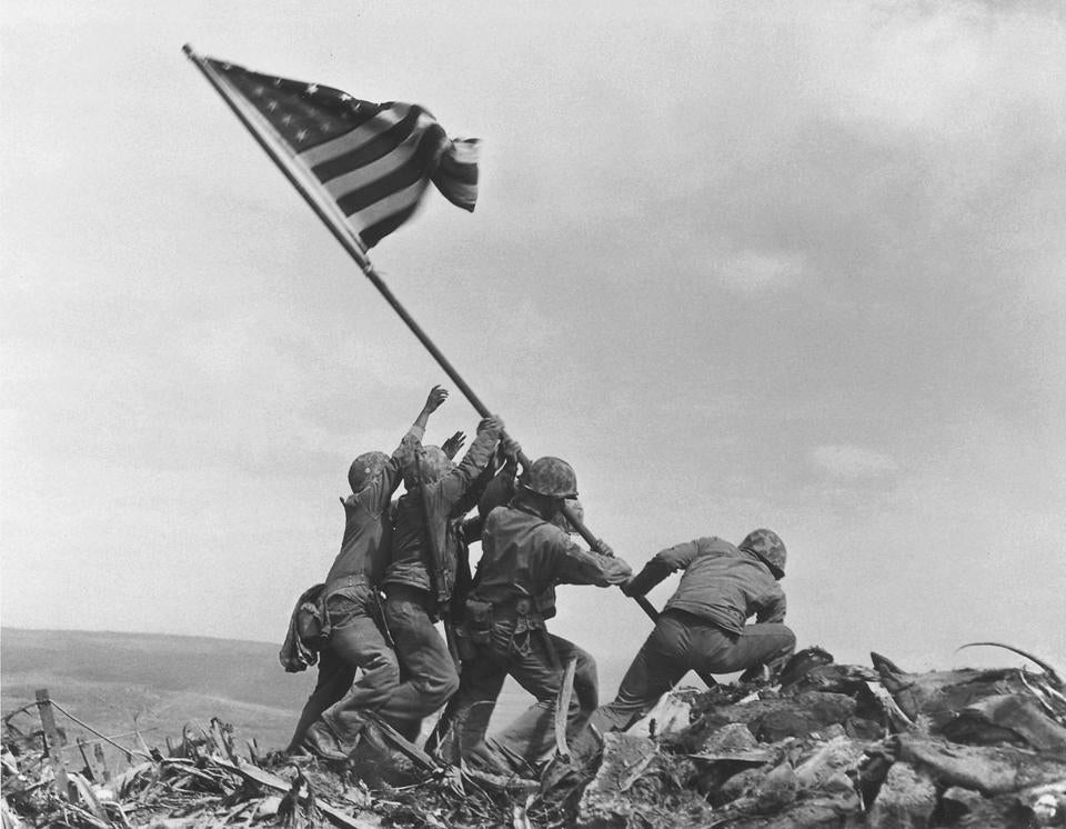US forces raised the American flag atop Mount Suribachi in Iwo Jima, Japan, on Feb. 23, 1945.