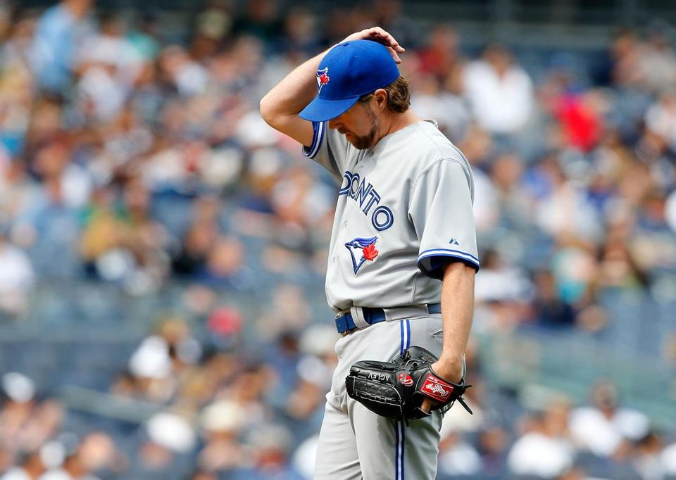 R.A. Dickey and the Blue Jays slumped to the bottom of the AL East after four weeks.