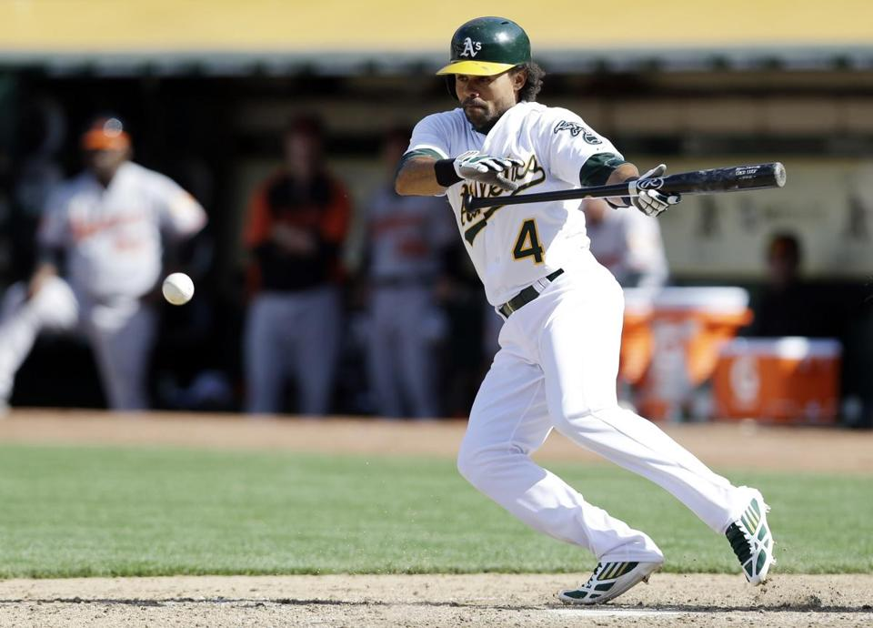 Oakland's Coco Crisp lays down a bunt in the 10th inning, which resulted in the winning run on Manny Machado's error.