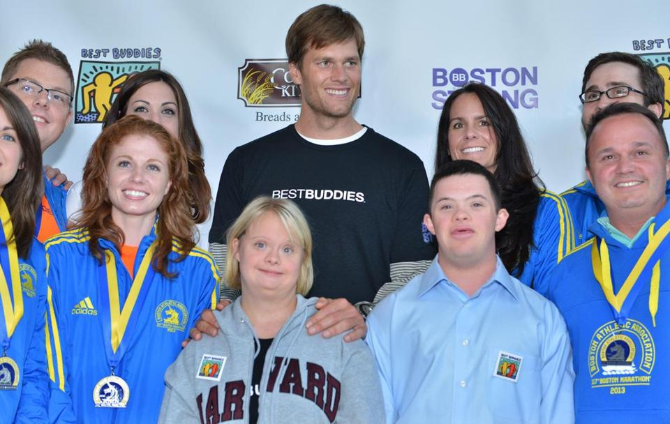 Tom Brady with Lauren Potter (front center) and Chris Harrington (front right) of Best Buddies and members from Team Tom Brady.