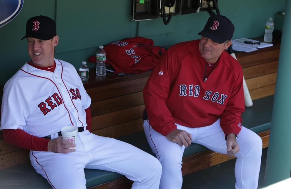Third base coach Brian Butterfield, left, has been an important addition to the staff of manager John Farrell, right.
