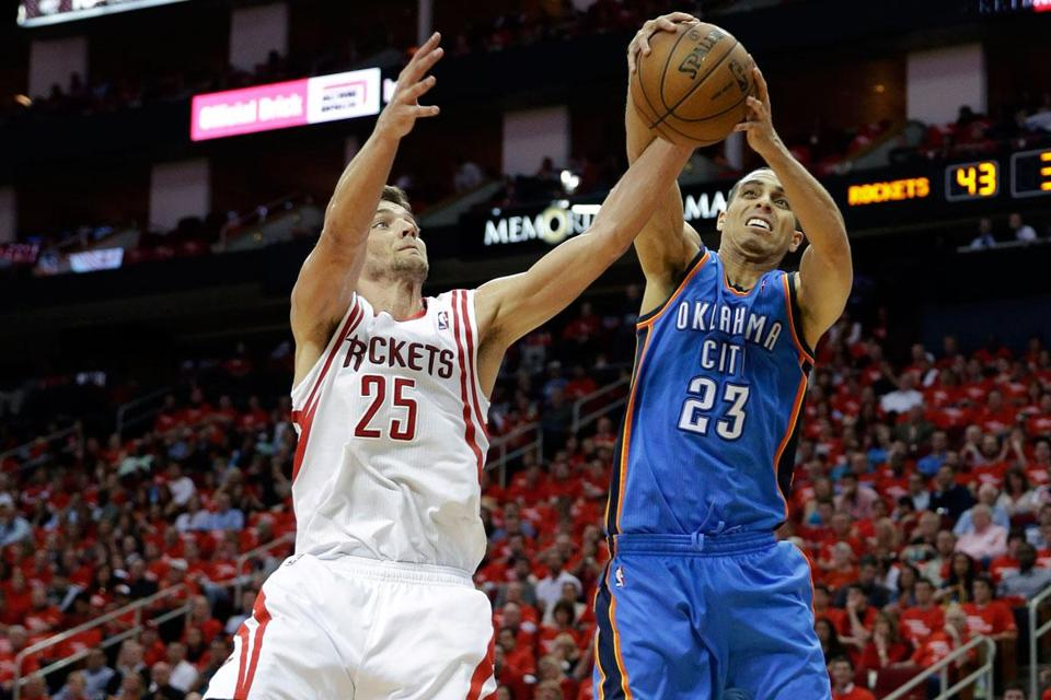 The Rockets' Chandler Parsons (team-high 27 points) was on the ball — as was Oklahoma City's Kevin Martin.