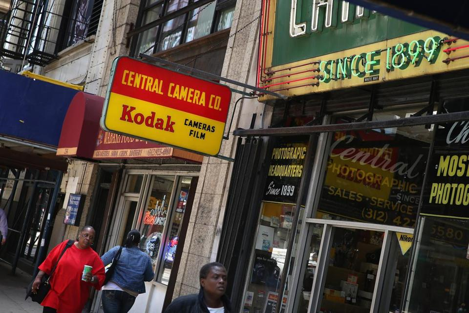 A vintage sign advertising Kodak film and cameras hung outside a Chicago store this week, but the company has sold off almost all of the businesses that made it famous.