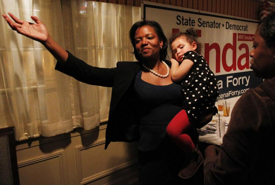 Linda Dorcena Forry held her daughter Madeline Forry, 2, as she celebrated a possible close victory at Phillips Freeport Tavern in Dorchester.