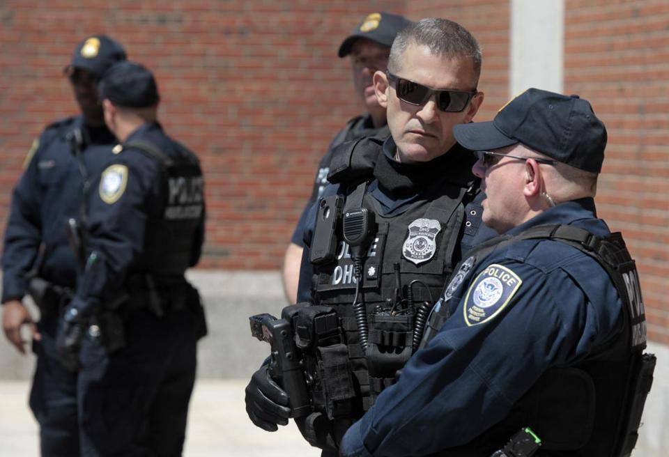 Officers stood guard outside the Moakley courthouse in Boston last week as three new suspects awaited arraignment in connection with the Marathon bombing case.