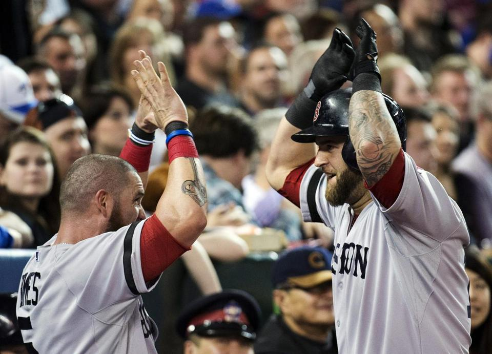 Jonny Gomes, left, congratulated Mike Napoli after one of his two home runs.
