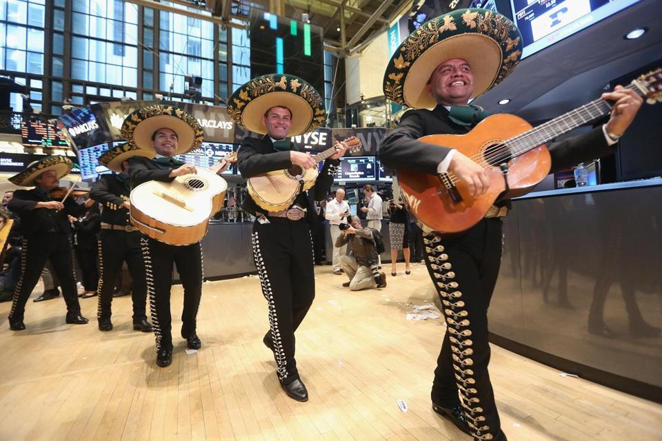 Mariachi Real De Mexico performed on the floor of the New York Stock Exchange after the closing bell and ahead of the Cinco de Mayo holiday, and a broker's cap said it all.
