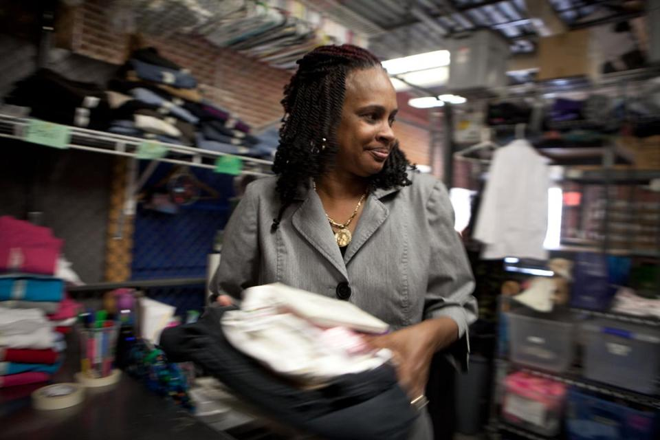 Deborah Conway gathered clothing for a new guest at Rosie's Place, a shelter for women.