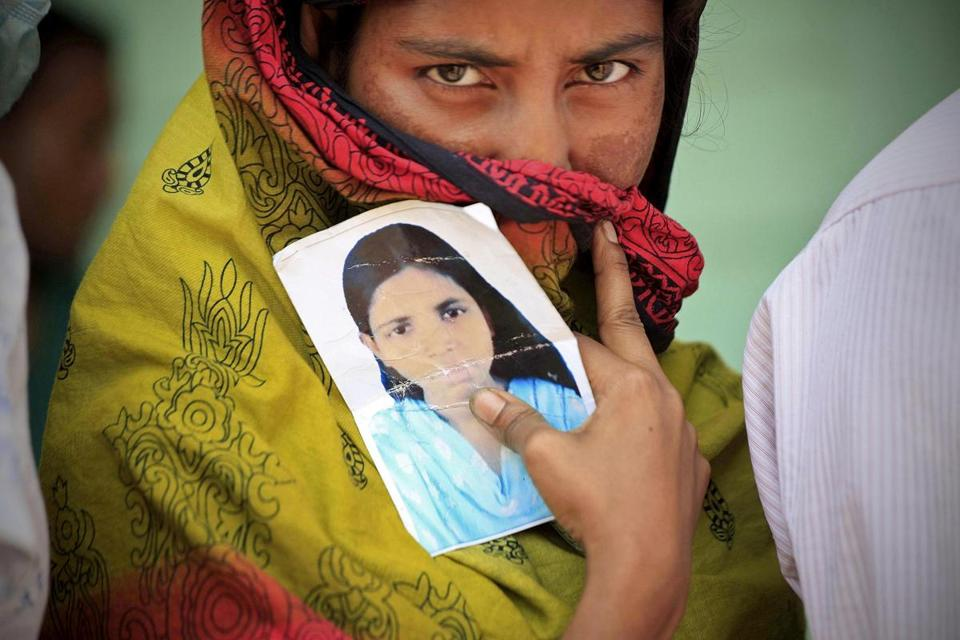 A woman held a photo of her sister, who has been missing since the factory collapse near Dhaka, Bangladesh.