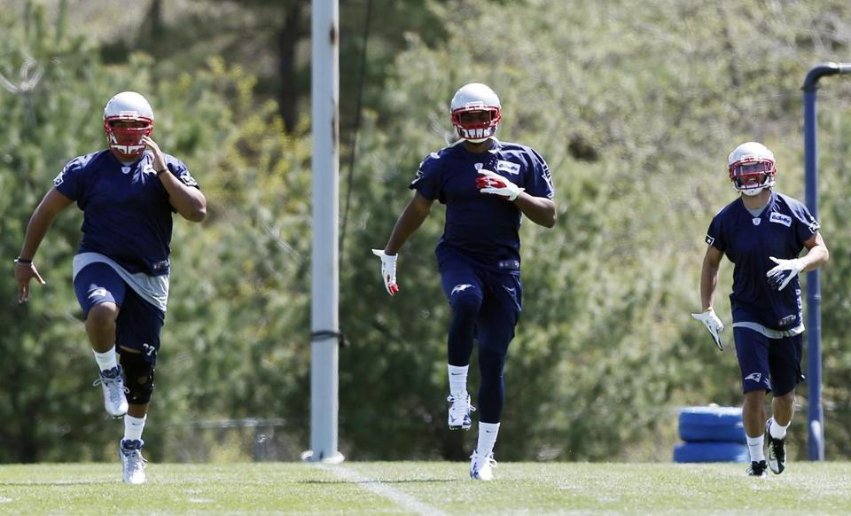 Cory Grissom, Jamie Collins and Brandon Jones (left to right) hopped to it during Patriots rookie minicamp.