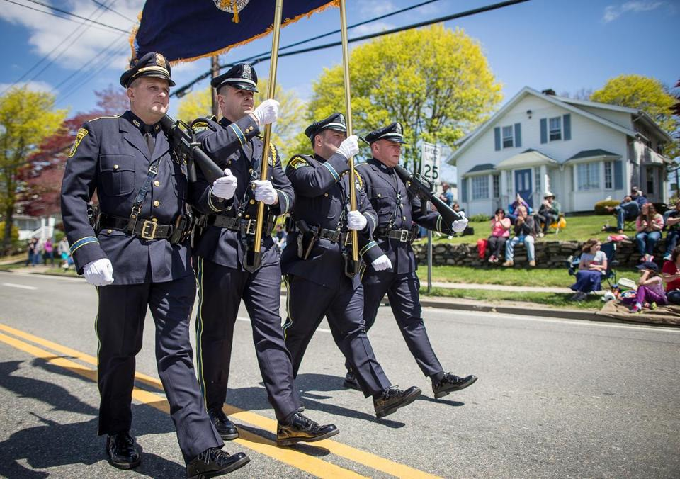 Christopher Munger (from left), Kevin McManus, Mark Lewis, and Richard Munger marched in Middletown, R.I., Sunday.