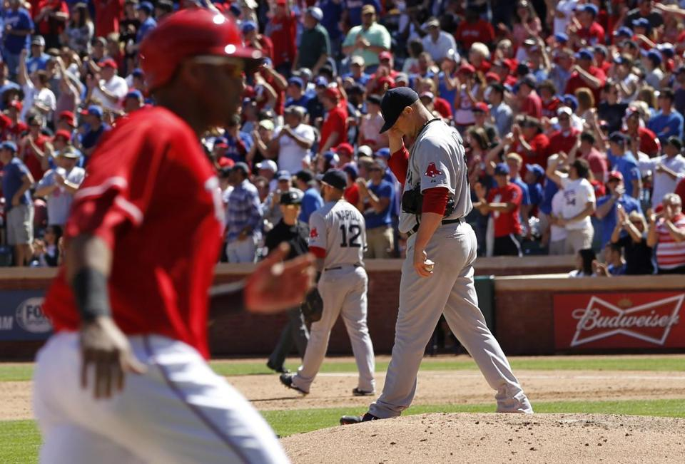 Jon Lester reacted as Nelson Cruz rounded third base after hitting a two-run home run in the sixth inning.