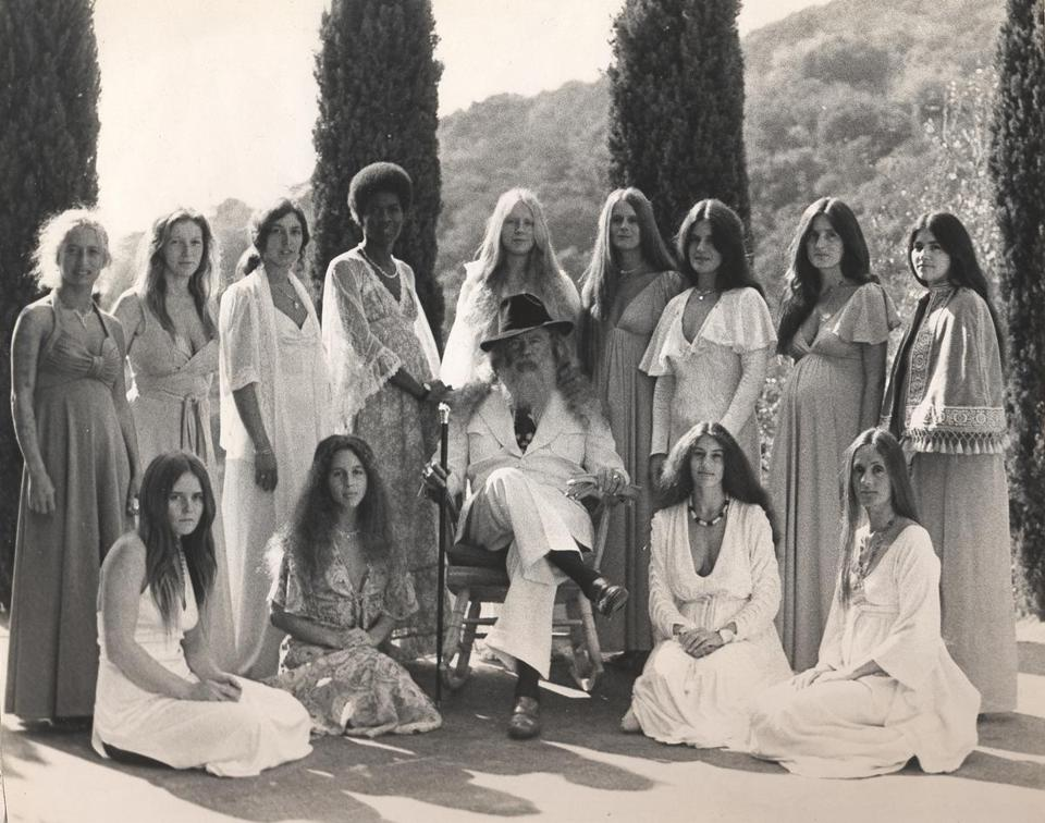 Above: Jim Baker, a.k.a. Father Yod, with his 13 wives in Los Angeles in 1973. Below: Baker in a star pose in 1971.