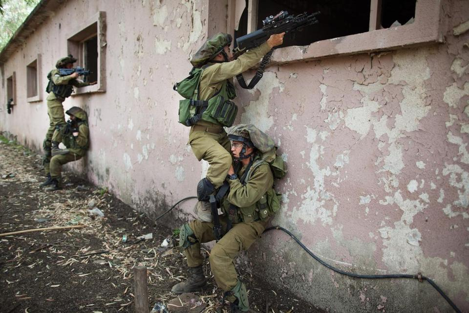 Israeli soldiers took part in an exercise at the border with Syria amid a report Syrian rebels may have used a nerve agent.