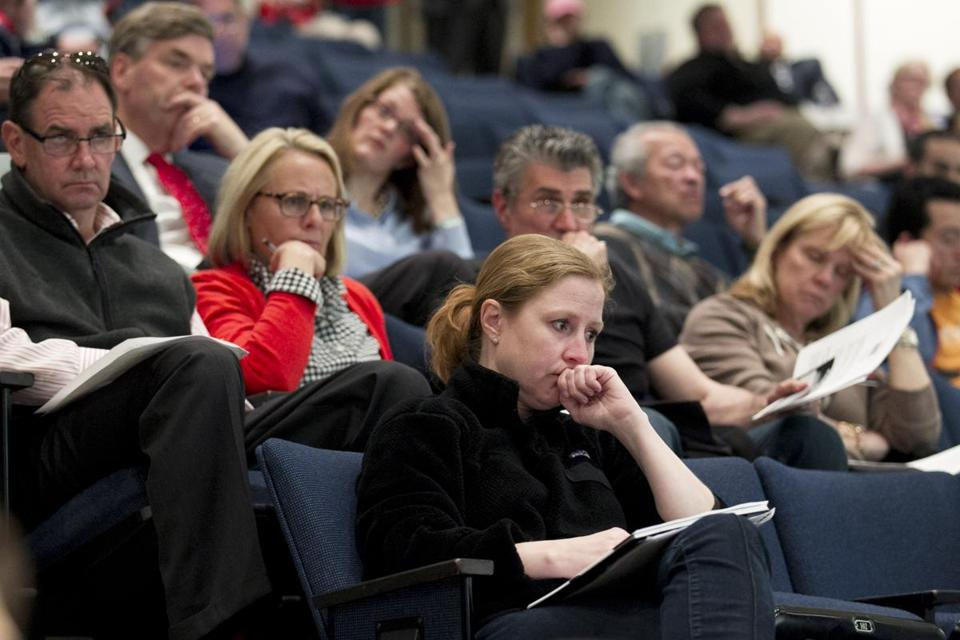 Audience members listened intently Monday night as One Fund Boston administrator Kenneth Feinberg outlined the proposed system for distributing funds to victims of the Marathon bombings.