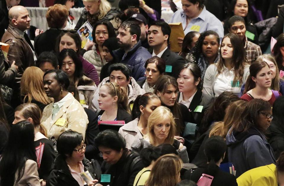 A job fair in New York. In March, there were 3.1 unemployed people, on average, for each job opening.