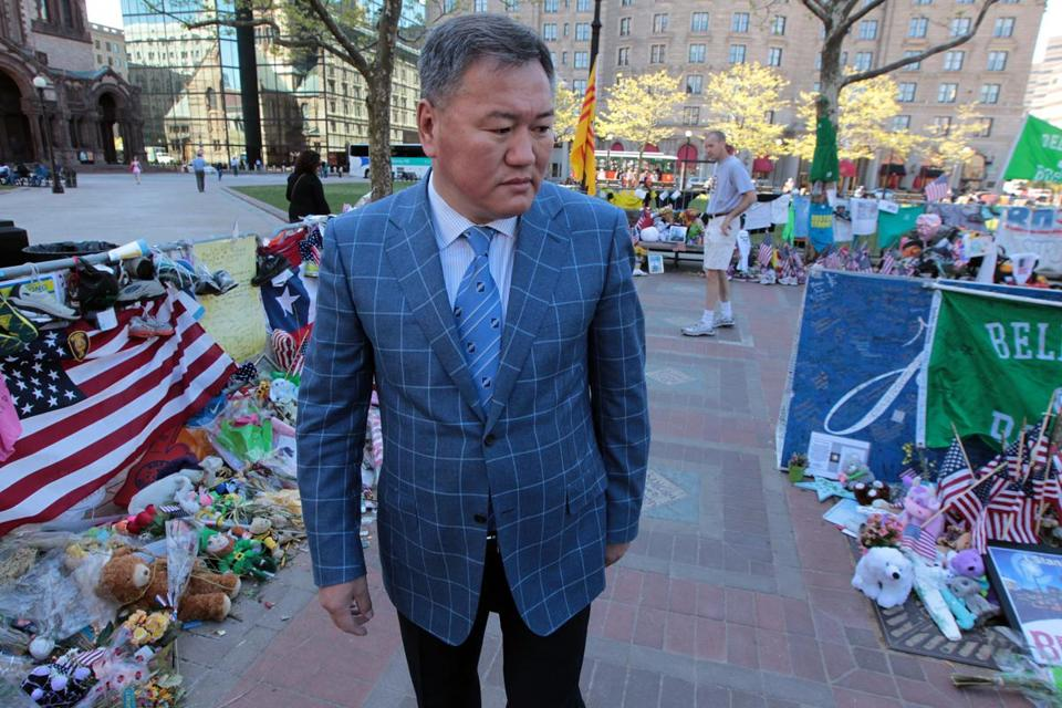 Amir Ismagulov, father of Azamat Tazhayakov, paid his respects at the memorial for the bombing victims.