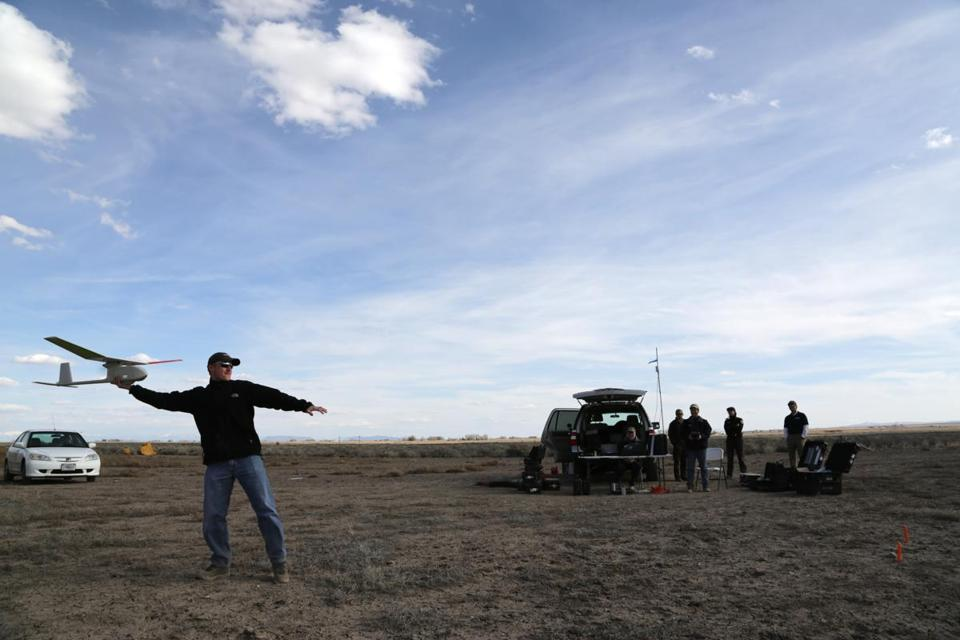 Mark Bauer, a contractor for the United States Geological Survey, launches a Raven drone at the Monte Vista National Wildlife Refuge in Southern Colorado. The small drone's first noncombat mission was counting sandhill cranes.