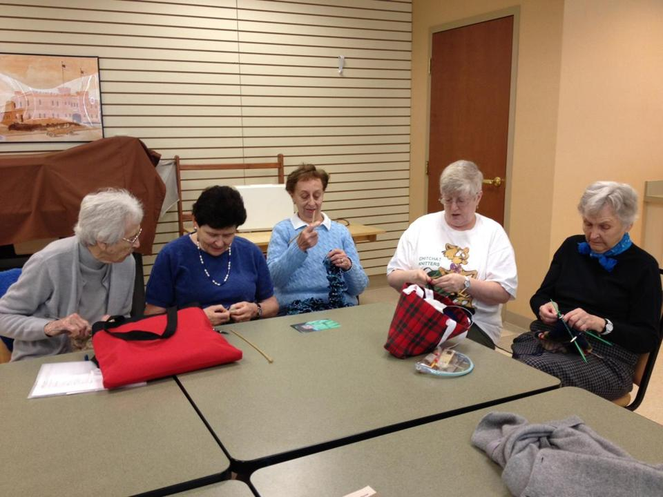 Members of the ChitChat Knitters at Linden Ponds in Hingham (from left) Phyllis Perry, Judith Shorr, Mitzi Anastopoulos, Deb Graham and Frankie Darrow. The group knits warm wear for various causes.