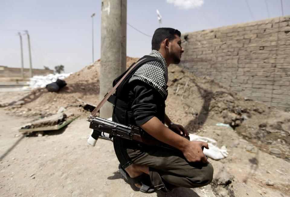 A Free Syrian Army fighter paused in east Syria on Monday.