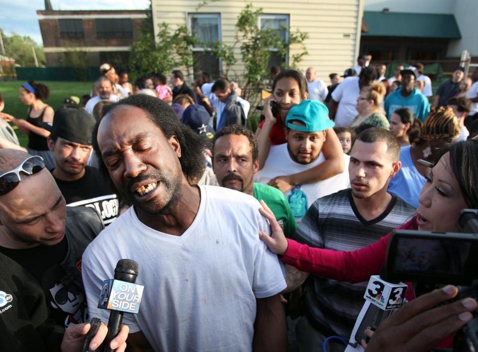 Charles Ramsey spoke to the media near the home on the 2200 block of Seymour Avenue, where three missing women were rescued in Cleveland on Monday.