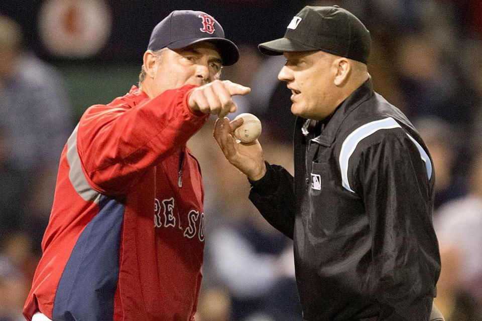 Plate ump Jeff Nelson wants to play ball, but Red Sox manager John Farrell wants to argue a call in the eighth.
