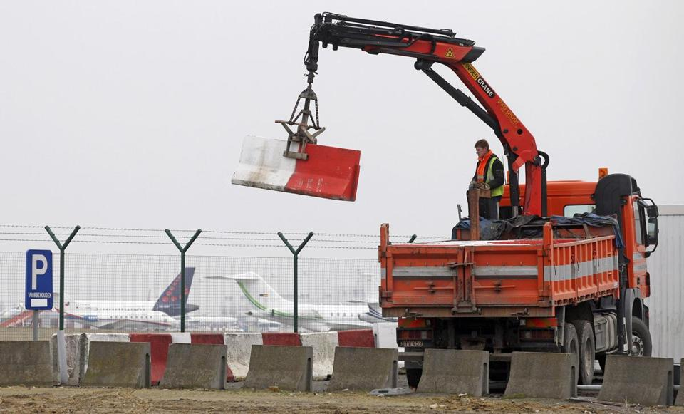 Workers placed concrete barriers to block access to a security fence next to the tarmac at Brussels International Airport after the Feb. 18 diamond robbery.