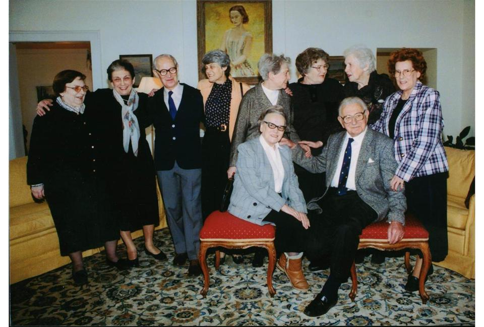 Sir Nicholas Winton (seated at right) in a reunion with some of those he rescued from the Nazis in Czechoslovakia when they were children. Below: Winton with one of the children.