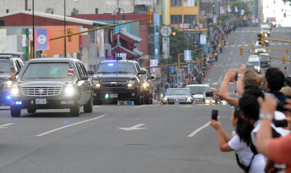 People watched and took pictures as President Obama's convoy traveled through the streets of San Jose, Costa Rica, this month during a three-day trip to the region.