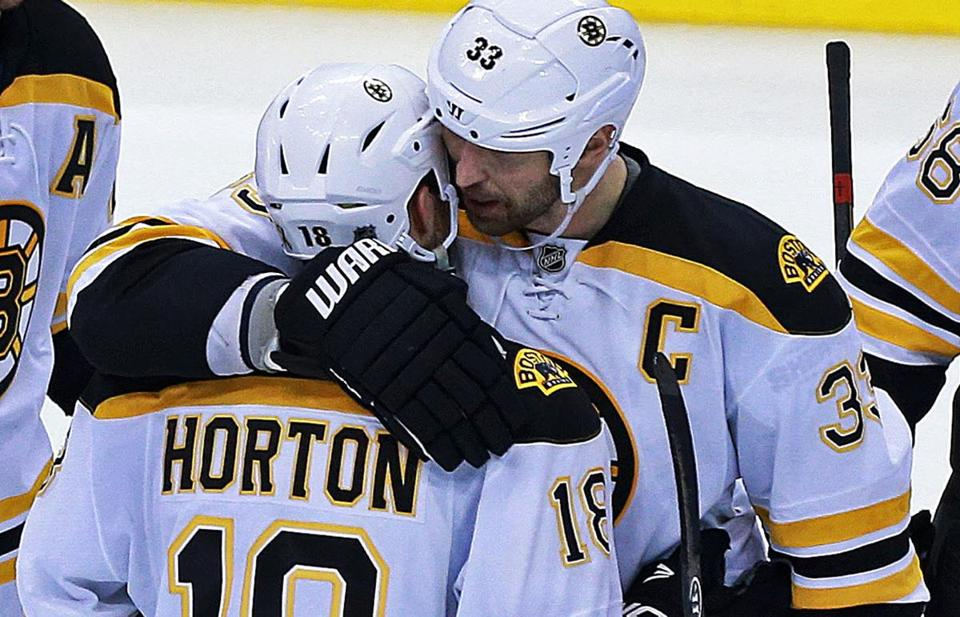 Zdeno Chara chats with Nathan Horton after Horton made a key sacrifice in OT to help deliver a victory in Game 4.